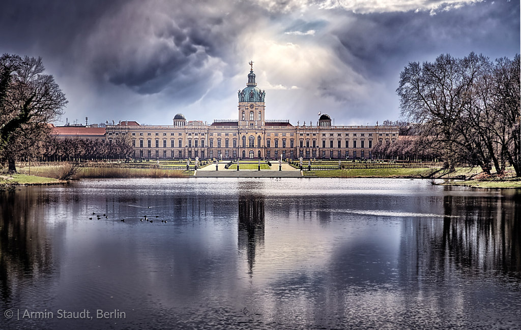 HDR shot of Schloss Charlottenburg Berlin with dramatic sky and lake