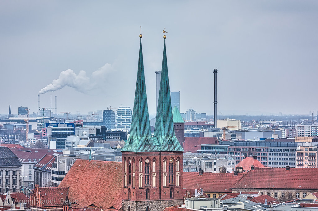 panorama fo Berlin with church and industry