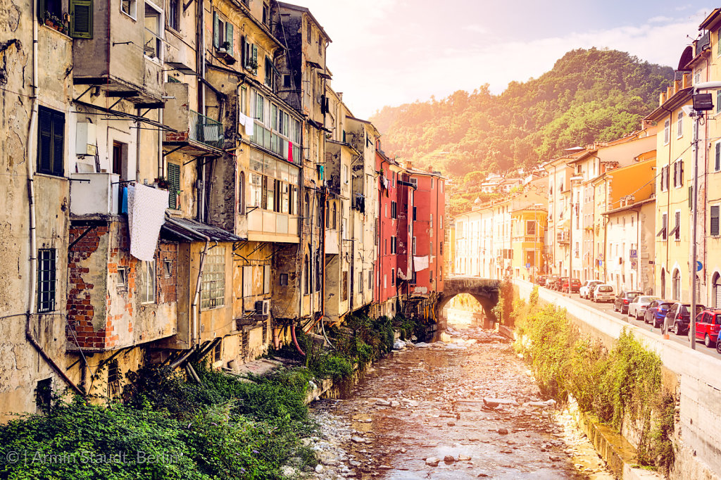 Carrara Italy, creek and old poor houses