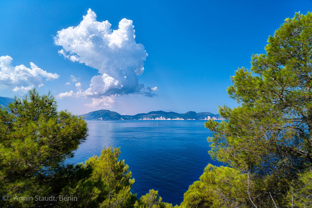 mediterranean landscape with ocean and dramatic clouds