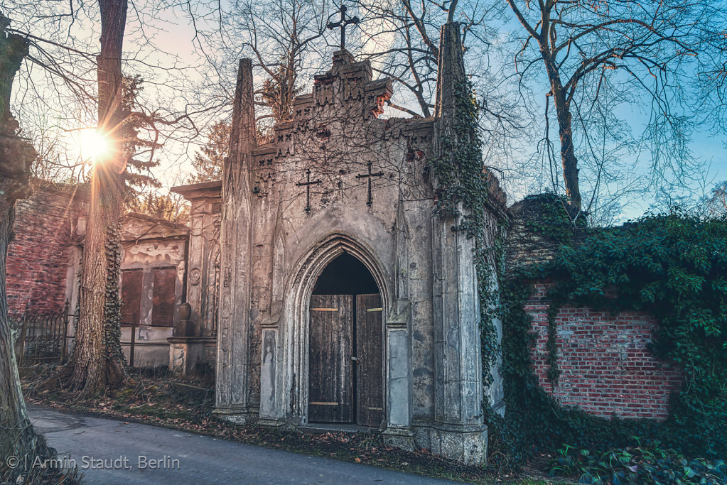 old tomb in gothic style with evening sun