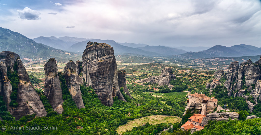 Rock formation and monastery in the mountain landscape of Meteora, Greece