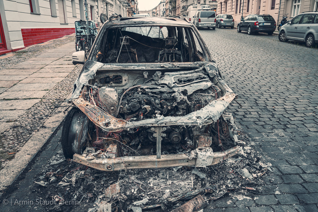 burnt out car in the streets of berlin